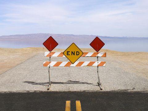 Road, Landscape, Sign, Slope, Horizon, Signage, Ecoregion, Asphalt, Traffic sign, Tar,