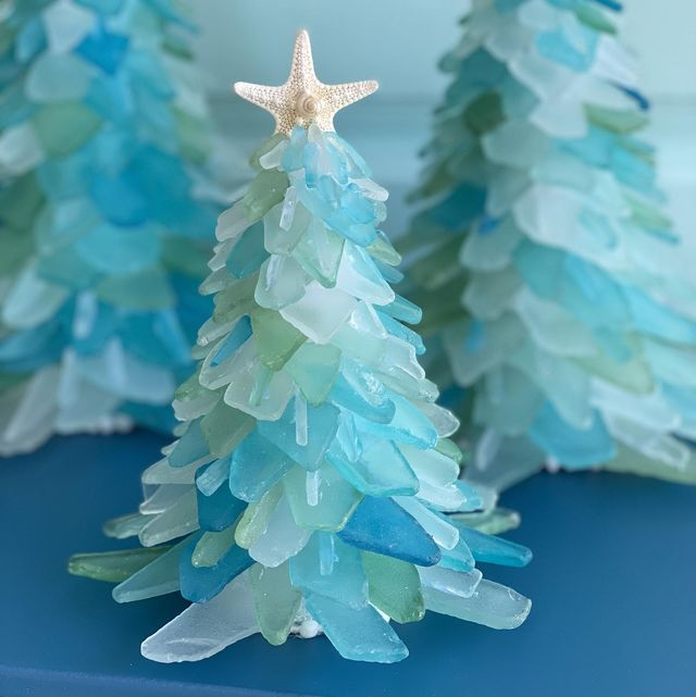 blue and green sea glass christmas tree with white starfish at the top