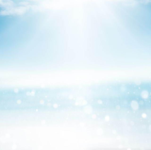 sea landscape with sun, sparkles and soft clouds