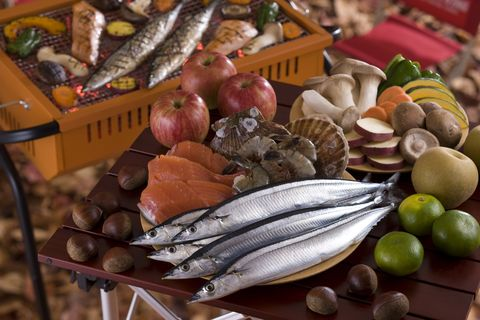 seafood, vegetable and fruit on table for barbecue in autumn