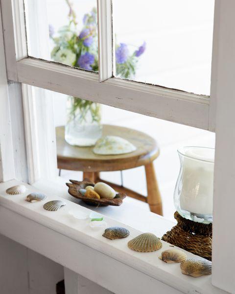 shells and seaglass on windowsill