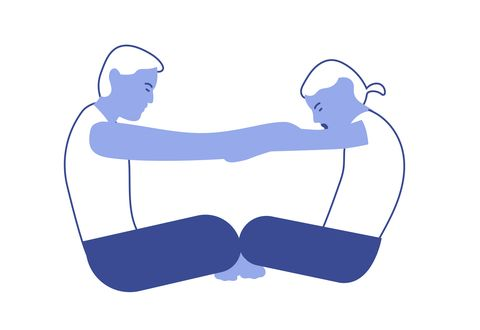 Couples yoga poses: seated cat cow