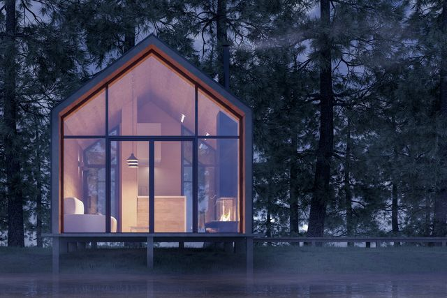 secluded tiny house on the sandy shore of a lake with fog in a coniferous forest in the cold night light and with warm light from the windows stock 3d illustration