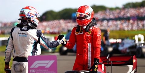 george russell junto a charles leclerc