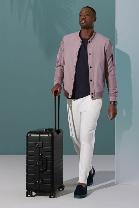Standing, Fashion, Suit, Shoulder, Baggage, Outerwear, Dress shirt, Blazer, Formal wear, Trousers,