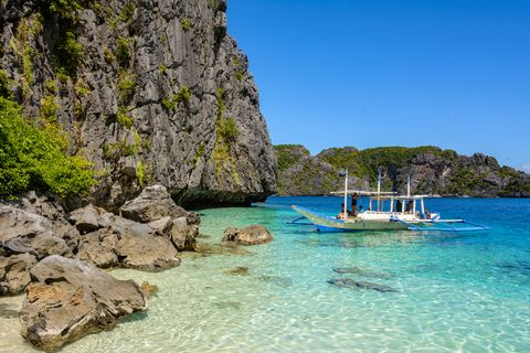 Secret lagoon with crystal clear water surrounded by rocks in El Nido Palawan. Philippine seascape with rocks. Tropical paradise in Asia