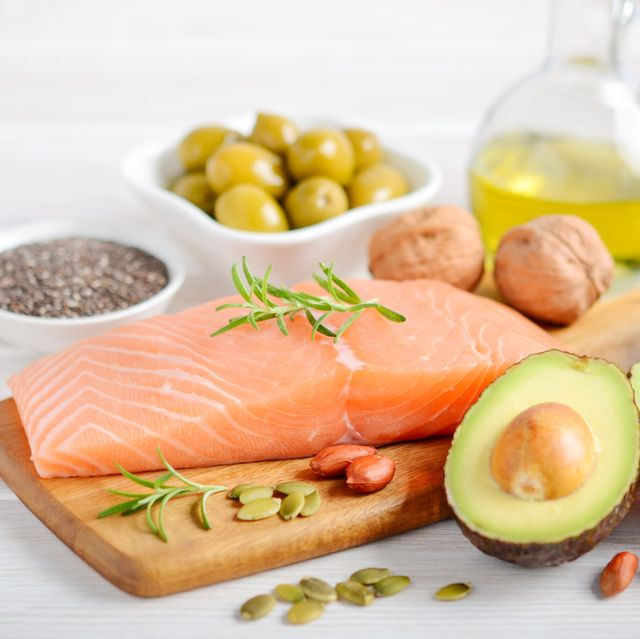 selection of healthy unsaturated fats, omega 3 fish avocado  olives nuts and seeds