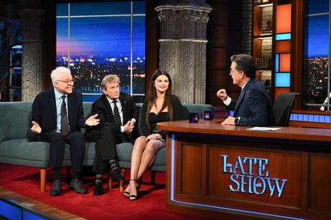 Selena Gomez In A Leather Mini Skirt And Versace Sweetheart Neckline Bodysuit In The Presentation Of Her Series On 'The Late Show With Stephen Colbert'