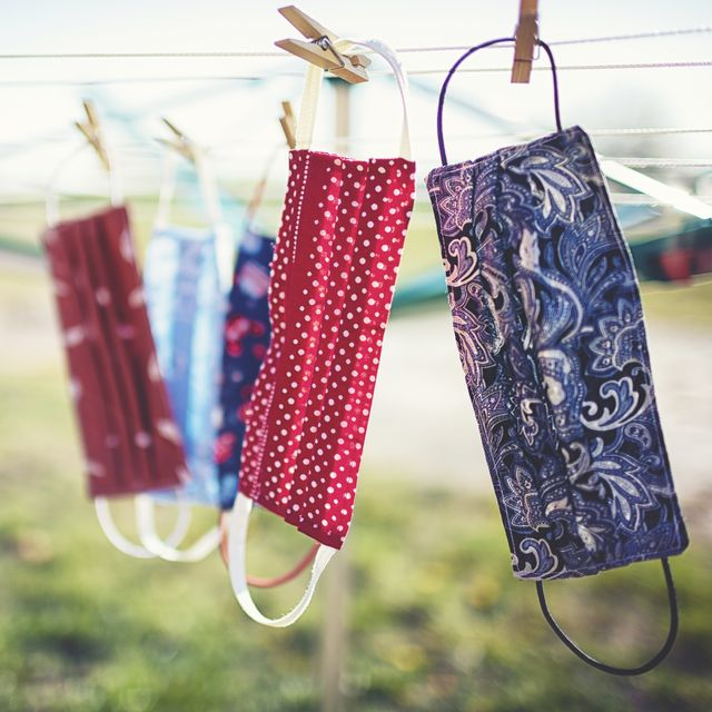self sewn mouth nose masks against corona viruses hang on the clothesline to dry