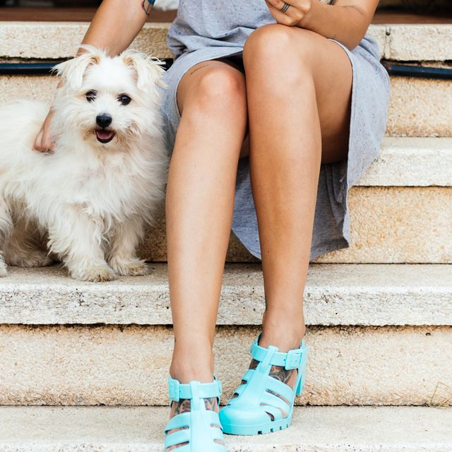 woman sitting on stoop with dog