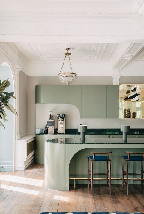 pale green kitchen with marble and brass handles by interior design studio sella concept