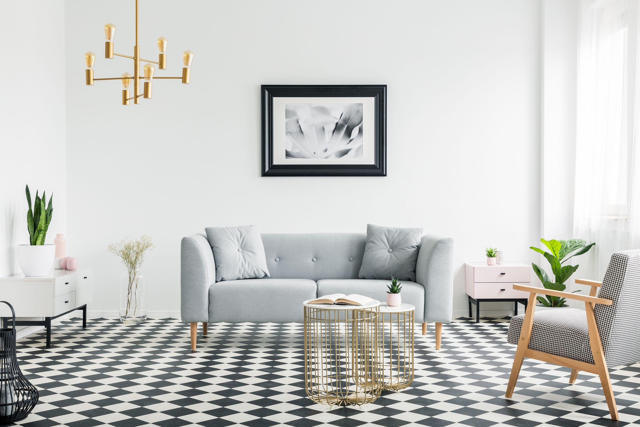 Gentil Poster Above Grey Sofa In Bright Patterned Living Room Interior With  Armchair And Gold Lamp.