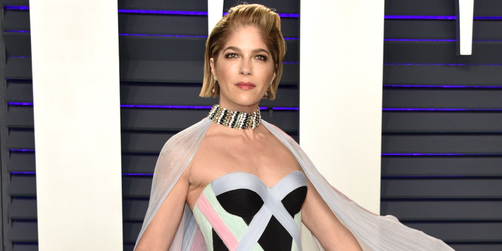 Selma Blair walks red carpet with a cane at Oscars after party