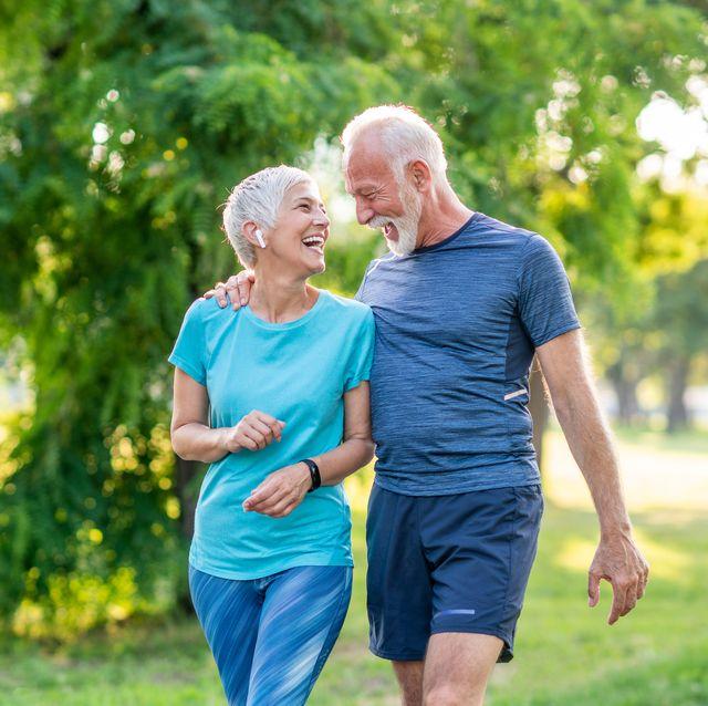 senior couple jogging at the park