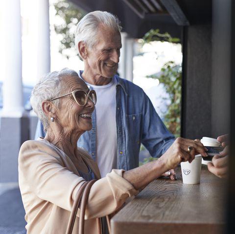 senior couple ordering coffee