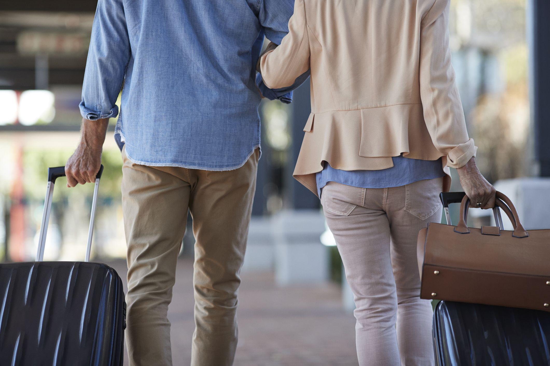 Senior couple walking together on public transport station
