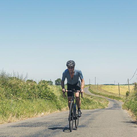 senior cyclist pushing hard