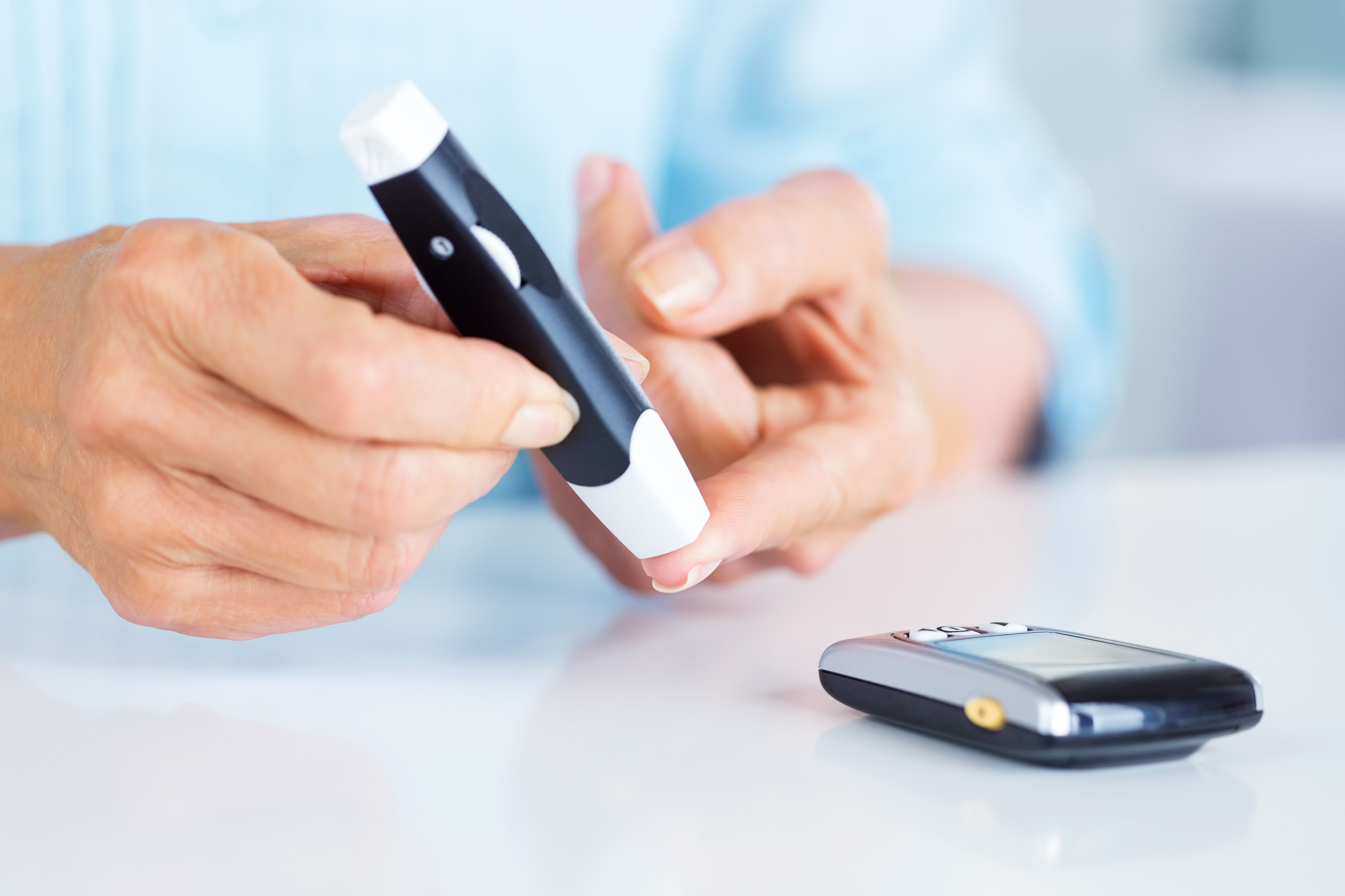 Senior Woman Checking Her Blood Sugar Level