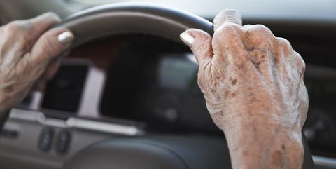 senior woman hands on steering wheel