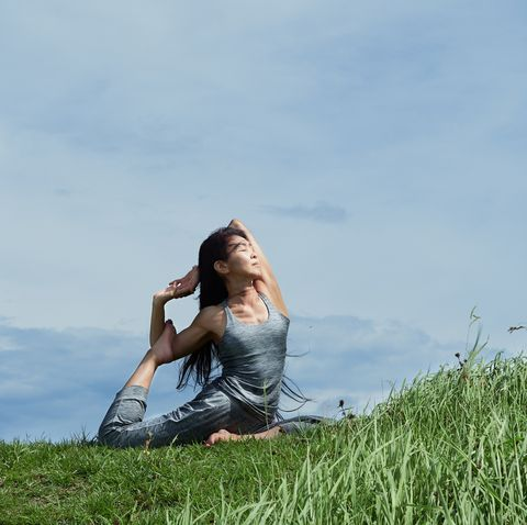 senior woman outdoors yoga coach
