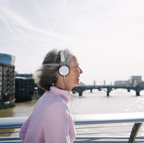 senior woman running in london downtown