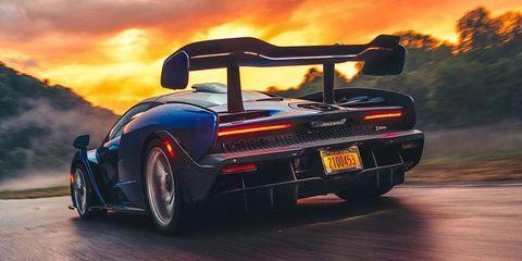 Land vehicle, Vehicle, Car, Automotive design, Supercar, Sports car, Performance car, Sky, Personal luxury car, Automotive exterior,