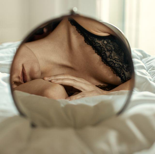 sensual woman relaxing in her bedroom