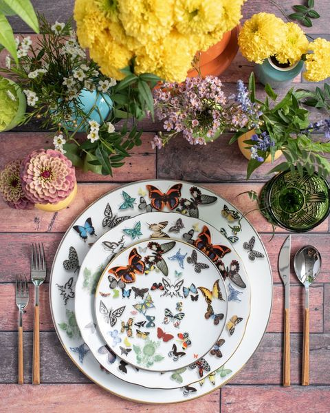 Dishware, Plate, Table, Yellow, Cut flowers, Flower, Tablecloth, Textile, Tableware, Plant,