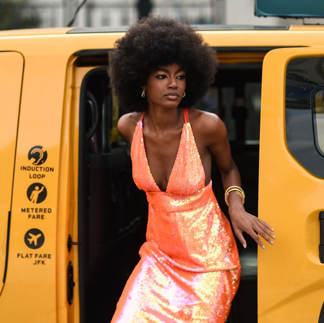 new york, new york   september 07 a guest is seen wearing an orange shiny dress outside the area show during new york fashion week ss20 on september 07, 2019 in new york city photo by daniel zuchnikgetty images