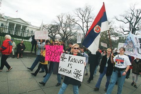 serb protestors march past the white house in wash
