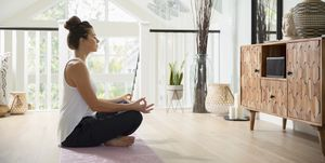Woman meditating - how to relieve money stress