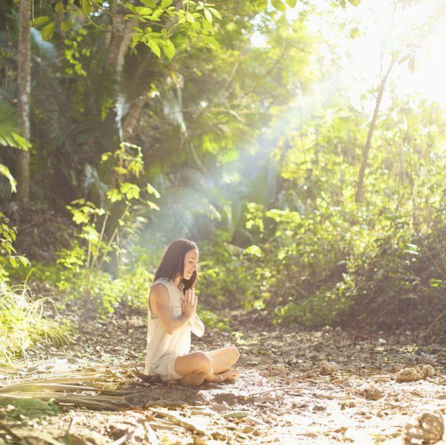 serene woman meditating in sunny, tranquil woods, sayulita, nayarit, mexico