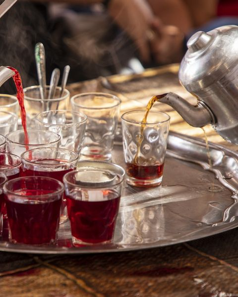 serving hibiscus tea in a nubian home in egypt