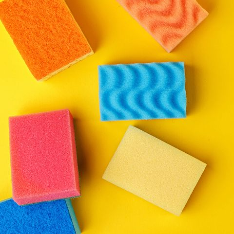 Set multi-colored sponges on a yellow background