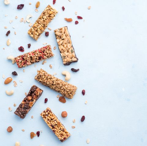 set of different granola bars on blue background
