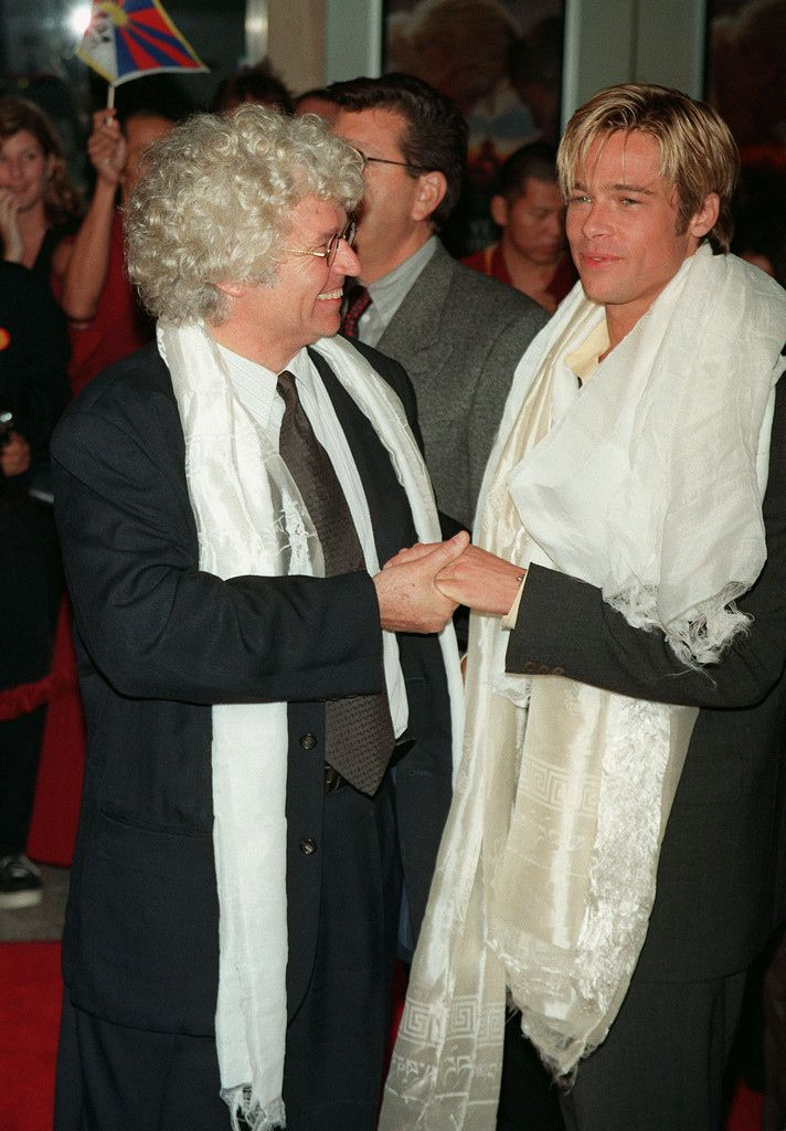 1997: With Jean-Jacques Annaud Pitt and director Jean-Jacques Annaud pose at the premiere of Seven Years in Tibet . The film's portrayal of the Chinese government resulted in Annaud and Pitt being banned from China after its release, but the Associated Press reports that Pitt returned in 2014 with then-wife Angelina Jolie.