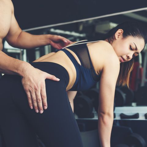 Sexual harassment at gym. Trainer touches women's butt in gym.