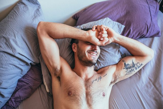 sexy man lying in bed, sexy man laying in bed