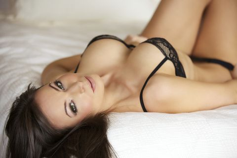 Sexy Young Woman in Lingerie on a Bed
