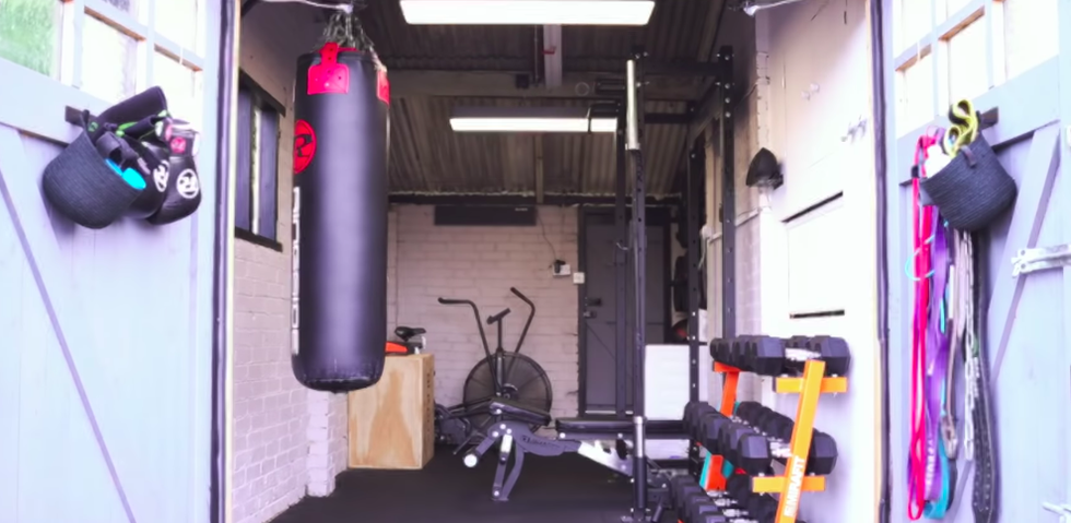 Watch This Bodybuilder Convert His Small Garage Into an Amazing Home Gym
