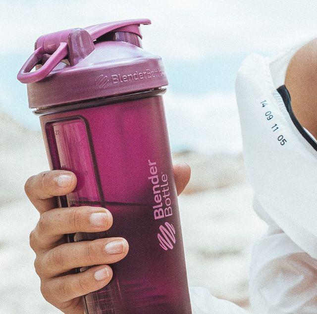 woman holding purple blenderbottle shaker bottle