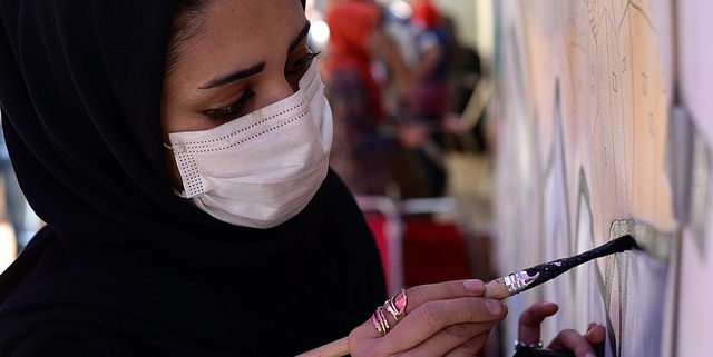 shamsia hassani, 25, paints graffiti at the french cultural center in kabul on may 1, 2013 hassani, perhaps afghanistans first serious graffiti artist, discovered street art after a visit by british graffiti artist chu to the afghan capital in 2010 afp photo shah marai        photo credit should read shah maraiafp via getty images