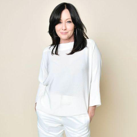 White, Clothing, Neck, Shoulder, Fashion model, Sleeve, Fashion, Leg, Outerwear, Trousers,