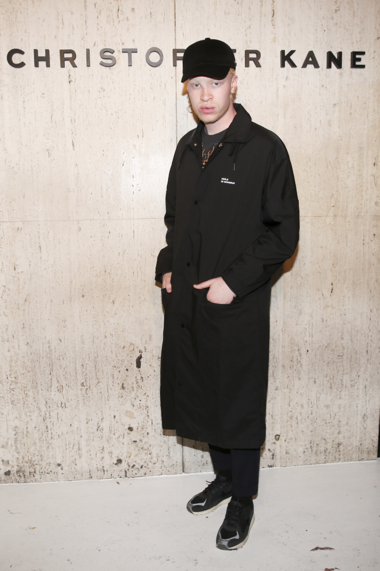 Clothing, Coat, Trench coat, Overcoat, Standing, Outerwear, Uniform, Street fashion,
