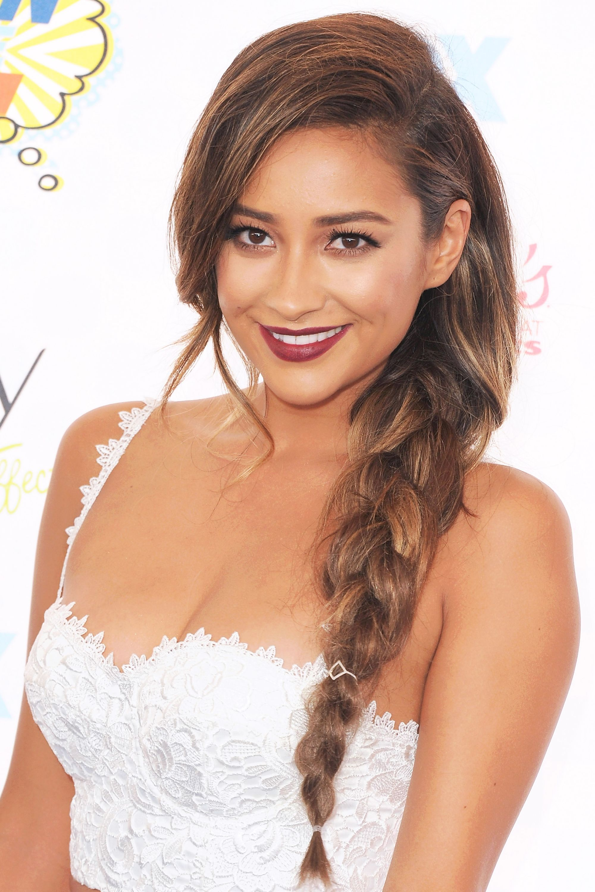 Shay Mitchell Mitchell creates the perfect pretty little side braid that shows off the actress' beautiful face. A tuck behind the ear also adds a sophisticated touch.