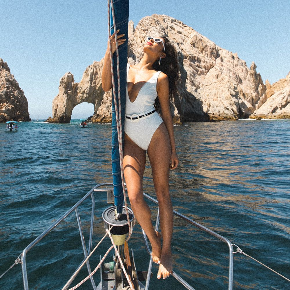 shay mitchell white solid and striped one piece swimsuit