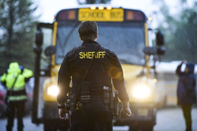 highlands ranch, co   may 07 a sheriffs officer watches as students get off busses after being evacuated to the recreation center at northridge after at least seven students were injured during a shooting at stem school highlands ranch on may 7, 2019 in highlands ranch, colorado photo by michael ciaglogetty images