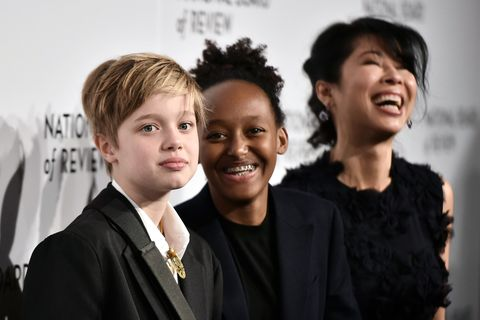 new york, ny   january 09 shiloh jolie pitt, zahara jolie pitt, and loung ung attend the 2018 the national board of review annual awards gala at cipriani 42nd street on january 9, 2018 in new york city  photo by steven ferdmanpatrick mcmullan via getty images