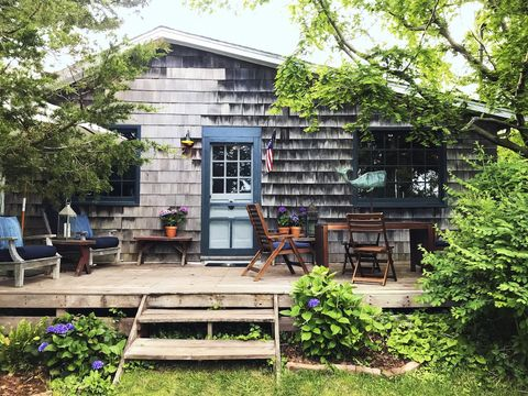 shingled beach cottage with blue door