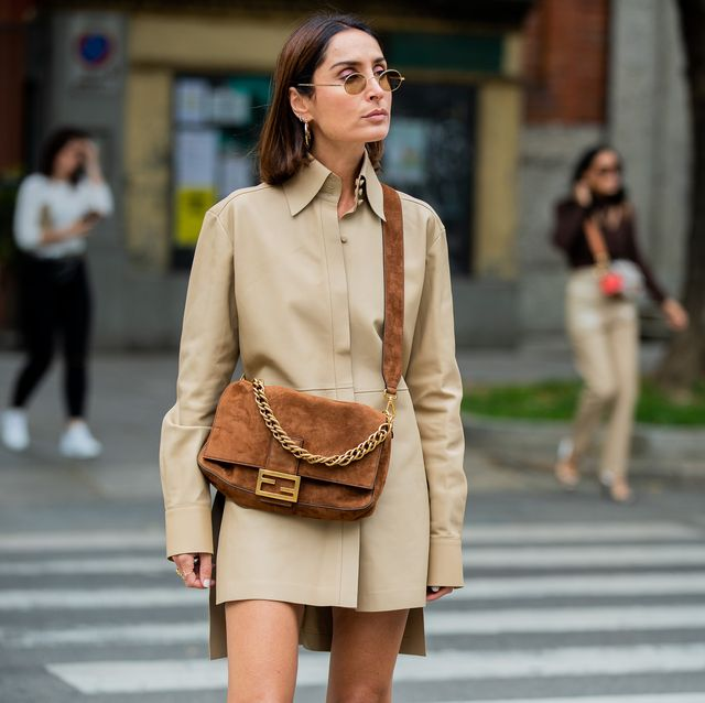 milan, italy   september 19 geraldine boublil wearing beige button up dress, brown bag seen outside the fendi show during milan fashion week springsummer 2020 on september 19, 2019 in milan, italy photo by christian vieriggetty images